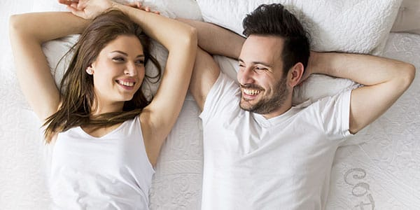 couple on amore mattress
