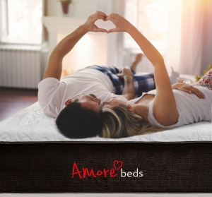 Couple Making A Heart On Amore Mattress